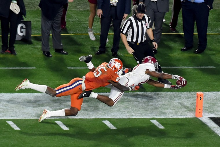 Kenyan Drake of the Alabama Crimson Tide scores on a punt return for a 95-yard touchdown in the fourth quarter against the Clemson Tigers during the 2016 College Football Playoff National Championship Game. (Norm Hall/Getty Images)
