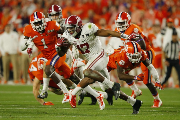 Kenyan Drakeof the Alabama Crimson Tide returns a punt for a 95-yard touchdown in the fourth quarter against the Clemson Tigers during the 2016 College Football Playoff National Championship Game. (Kevin C. Cox/Getty Images)