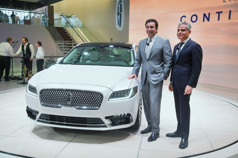 Mark Fields (left), president and chief executive officer of Ford Motor Company, and Kumar Galhotra, president of Lincoln, pose during the introduction of the 2017 Continental at the North American International Auto Show on January 12, 2016 in Detroit, Michigan. The car was introduced as a concept at the 2015 New York Auto Show. The Detroit show is open to the public from January 16-24. (Photo by Scott Olson/Getty Images)