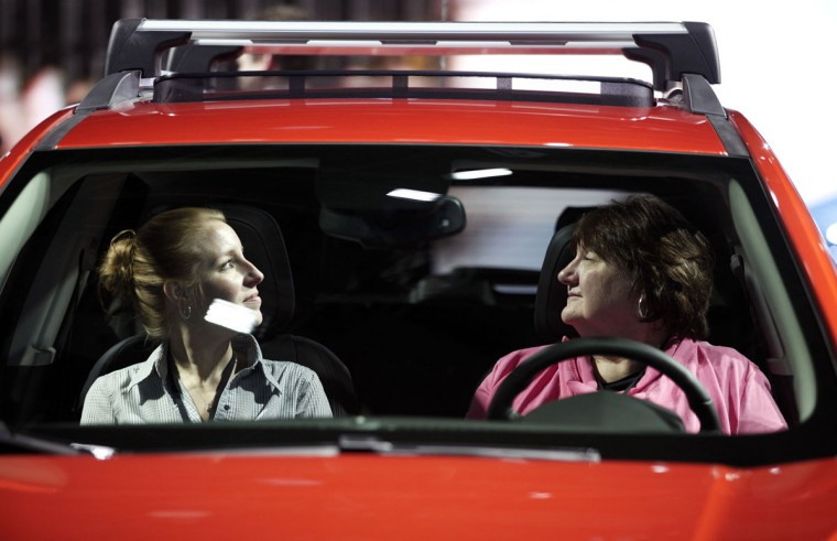 Stacey Boyle (left) of Rochester Hills, Michigan and Susan Bairley (right) of Chelsea, Michigan examine the cab of the Ford Trax at the Ford exhibit he exhibit at the 2016 North American International Auto Show January 12, 2016 in Detroit, Michigan. (Photo by Bill Pugliano/Getty Images)