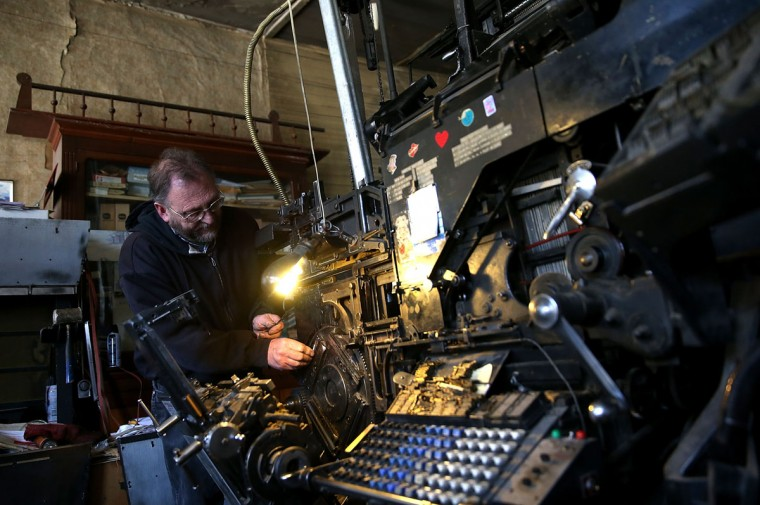 Saguache Crescent owner and editor Dean Coombs makes repairs to a vintage hot metal Linotype typesetting machine as he creates metal type slugs to be used to print the Saguache Crescent newspaper on January 18, 2016 in Saguache, Colorado. The Saguache Crescent newspaper is the last newspaper in the United States that is produced using a Linotype hot metal typesetting machine. Dean Coombs, the paper's owner and editor, has been publishing the small town newspaper once a week using a Linotype machine that was purchased new in 1921, a few years after his family took over the paper in 1917. Coombs has been running the business by himself for the past 38 years and has no plans of shutting its doors anytime soon. Most newspapers discontinued the use of Linotypes over 40 years ago and were replaced with offset lithography printing and computer typesetting. (Photo by Justin Sullivan/Getty Images)
