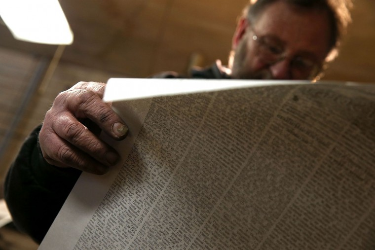 Saguache Crescent owner and editor Dean Coombs inspects a freshly printed copy of the Saguache Crescent on January 19, 2016 in Saguache, Colorado. The Saguache Crescent newspaper is the last newspaper in the United States that is produced using a Linotype hot metal typesetting machine. Dean Coombs, the paper's owner and editor, has been publishing the small town newspaper once a week using a Linotype machine that was purchased new in 1921, a few years after his family took over the paper in 1917. Coombs has been running the business by himself for the past 38 years and has no plans of shutting its doors anytime soon. Most newspapers discontinued the use of Linotypes over 40 years ago and were replaced with offset lithography printing and computer typesetting. (Photo by Justin Sullivan/Getty Images)