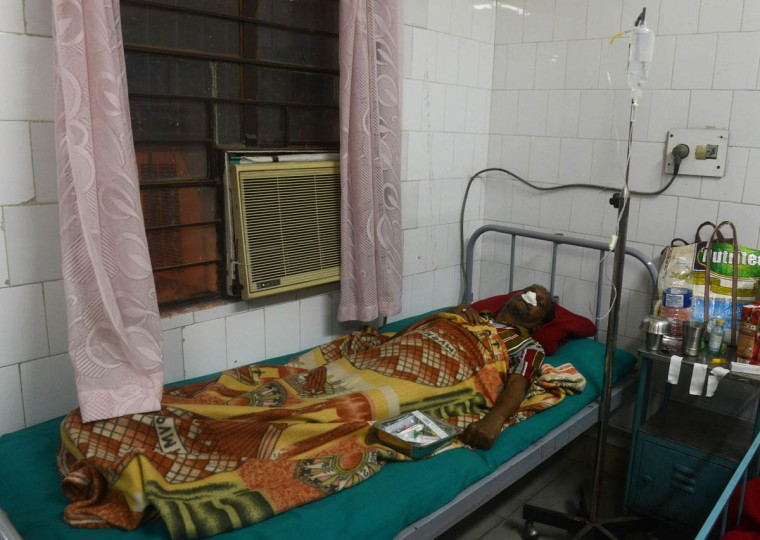 Injured local resident Gouranga Saha, 68, lies in a bed after receiving treatment at Siliguri Hospital following an earthquake in Siliguri on January 4, 2016. A strong 6.7 magnitude earthquake struck northeast India near the country's borders with Myanmar and Bangladesh early on January 4, sending people fleeing into the streets with dozens injured in the panic. (Diptendu Dutta/AFP/Getty Images)