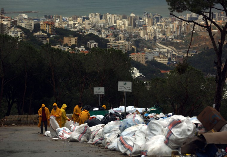 Syrian workers employed by local non governmental organisations (NGO) pack garbage near a forest in the town of Ain Saadeh north east of the Lebanese capital, Beirut, on January 8, 2016. (PATRICK BAZ/AFP/Getty Images)