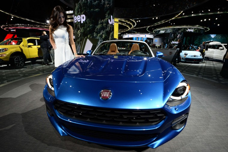 A model poses next to the 2016 Fiat 124 Spider during the press preview of the 2016 North American International Auto Show in Detroit, Michigan, on January 12, 2016. (JEWEL SAMAD/AFP/Getty Images)