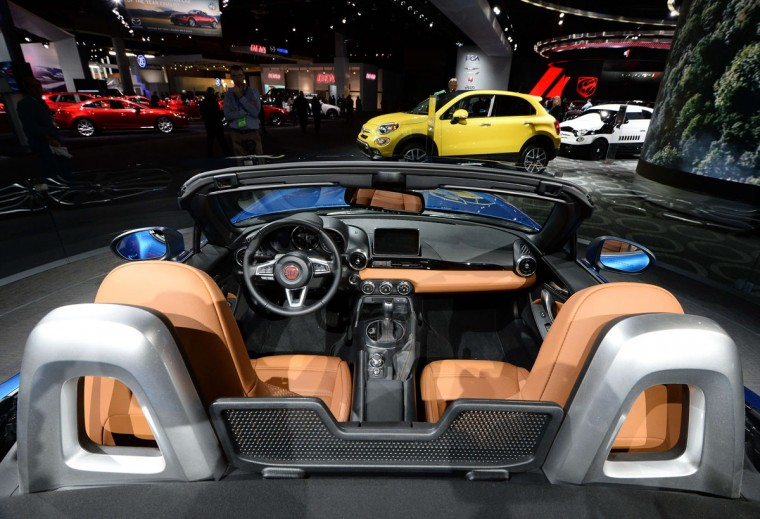 The 2016 Fiat 124 Spider is pictured during the press preview of the 2016 North American International Auto Show in Detroit, Michigan, on January 12, 2016. (JEWEL SAMAD/AFP/Getty Images)