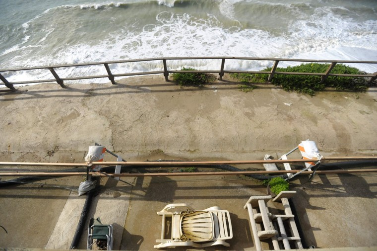 A view from a second story apartment shows a fence line (C) where an unstable cliff is in danger of giving way in Pacifica, California on January 26, 2016. Storms and powerful waves caused by El Nino have been intensifying erosion along nearby coastal bluffs and beaches in the area. (JOSH EDELSON/AFP/Getty Images)
