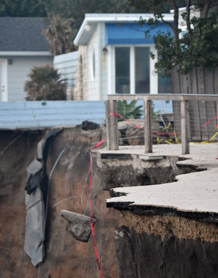 Chunks of concrete and houses hang over a cliff in Pacifica, California on January 26, 2016. Storms and powerful waves caused by El Nino have been intensifying erosion along nearby coastal bluffs and beaches in the area. (JOSH EDELSON/AFP/Getty Images)