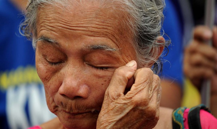 "A Filipina ""comfort woman"", a sex slave for the Japanese Imperial army during World War II, wipes a tear during a protest near the Malacanang Palace in Manila where visiting Japanese Emperor Akihito is meeting the Philippine president on January 27, 2016. The few remaining comfort women joined the protest calling to ""right the historical wrong"" as the Japanese emperor and empress are on a five-day visit to the Philippines.     