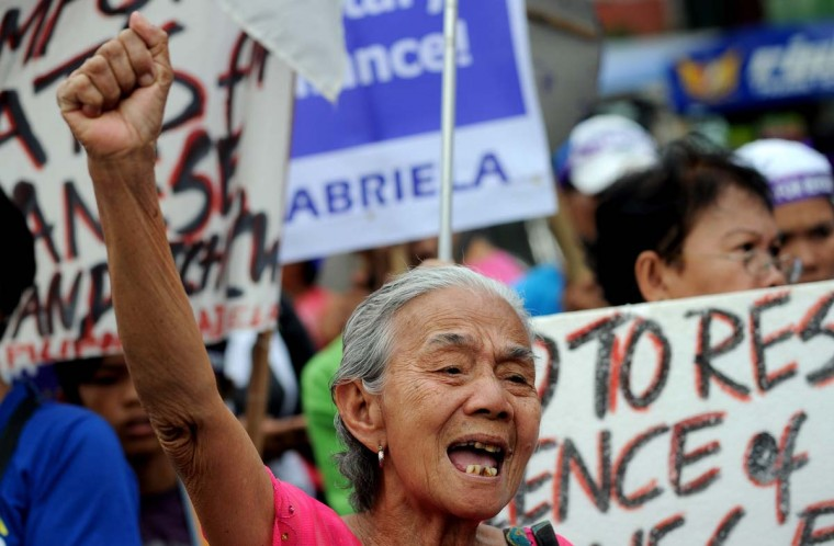 "A Filipina ""comfort woman"", a sex slave for the Japanese Imperial army during World War II, joins in a protest near the Malacanang Palace in Manila where visiting Japanese Emperor Akihito is meeting the Philippine president on January 27, 2016. The few remaining comfort women joined the protest calling to ""right the historical wrong"" as the Japanese emperor and empress are on a five-day visit to the Philippines.     