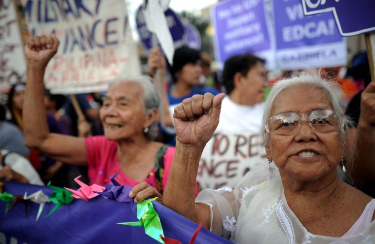 "Filipina ""comfort women"", sex slaves for the Japanese Imperial army during World War II, join in a protest near the Malacanang Palace in Manila where visiting Japanese Emperor Akihito is meeting the Philippine president on January 27, 2016. The few remaining comfort women joined the protest calling to ""right the historical wrong"" as the Japanese emperor and empress are on a five-day visit to the Philippines.     