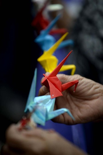 "A Filipina ""comfort woman"", a sex slave for the Japanese Imperial army during World War II, holds an origami paper peace dove as she participates in a protest near the Malacanang Palace in Manila where visiting Japanese Emperor Akihito is meeting the Philippine president on January 27, 2016. The few remaining comfort women joined the protest calling to ""right the historical wrong"" as the Japanese emperor and empress are on a five-day visit to the Philippines.  NOEL CELIS - AFP/Getty Images"