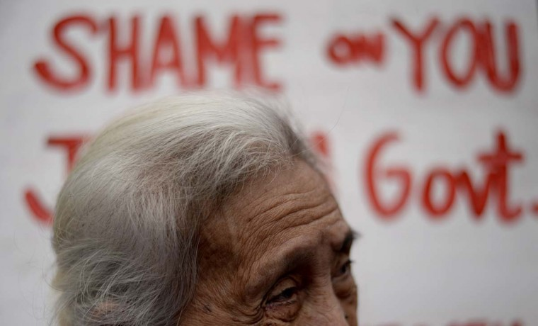 "A Filipina ""comfort woman"", a sex slave for the Japanese Imperial Army during World War II, participates in a protest near the Malacanang Palace in Manila where visiting Japanese Emperor Akihito is meeting the Philippine president on January 27, 2016. The few remaining comfort women joined the protest calling to ""right the historical wrong"" as the Japanese emperor and empress are on a five-day visit to the Philippines.     