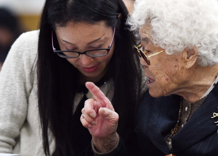 South Korean former comfort women Lee Ok-Sun (R) speaks to an interpreter (L) prior to a meeting with Japanese supporters in Tokyo on January 27, 2016.  A South Korean woman forced into sexual slavery for Japanese soldiers more than 70 years ago heaped scorn January 27 on an agreement between Tokyo and Seoul aimed at settling the so-called comfort women issue.     || CREDIT: TOSHIFUMI KITAMURA - AFP/GETTY IMAGES
