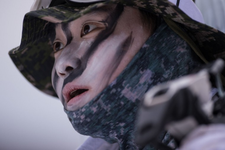 A South Korean soldier walks in the snow during a joint annual winter exercise in Pyeongchang, some 180 kilometers east of Seoul, on January 28, 2016. The Korean peninsula is the world's last Cold War frontier as Stalinist North Korea and pro-Western South Korea have been technically at war since the 1950-53 conflict. (ED JONES/AFP/Getty Images)