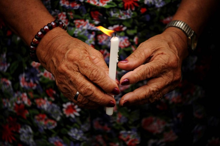 "A Filipina ""comfort woman"", a sex slave for the Japanese Imperial Army during World War II, holds a lit candle for the women who have died over the years due to age as she participates in a protest in front of the Japanese Embassy in Manila to coincide with the visit of Japanese Emperor Akihito to the country on January 29, 2016. The few remaining comfort women have taken part in daily protests calling to ""right the historical wrong"" as the Japanese emperor and empress are on a five-day visit to the Philippines.    