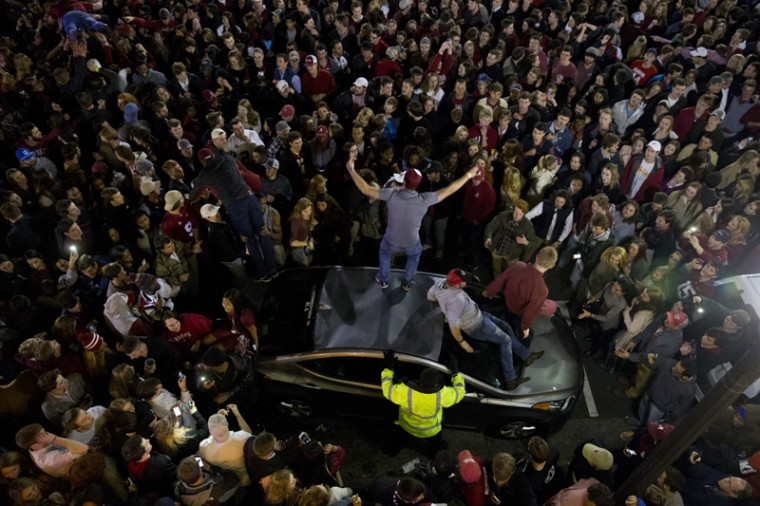 Fans in Tuscaloosa, Alabama, cheer after Alabama defeated Clemson in the NCAA college playoff championship football game. (Brynn Anderson/AP)