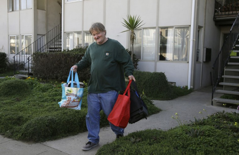 Garth Yeaman carries some of his belongings after being forced to evacuate his apartment Monday, Jan. 25, 2016, in Pacifica, Calif. El Nino storms delivering crashing waves and powerful rain storms have put homes perched atop coastal bluffs near San Francisco in danger, forcing residents of an apartment complex on Monday to leave. (AP Photo/Eric Risberg)