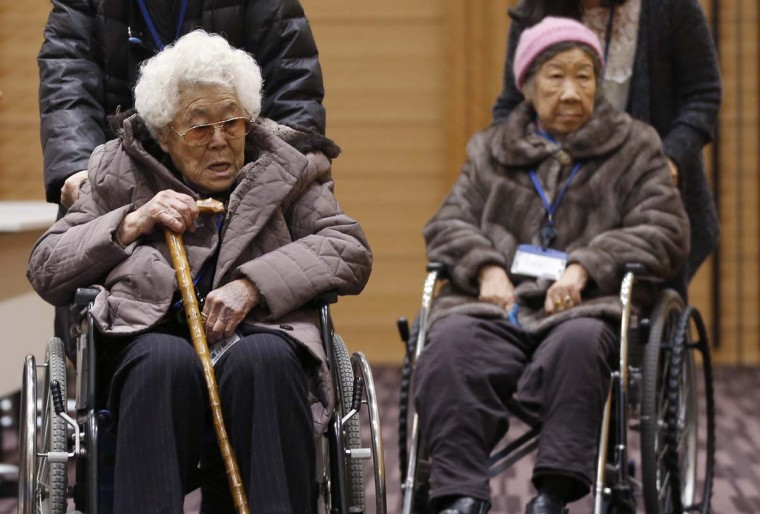 Lee Ok-sun, left, and Kang Il-chul, South Korean women abused by Japan's wartime military-run brothel system, arrive at a press conference in Tokyo, Tuesday, Jan. 26, 2016. Lee, 88, and Kang, 87, are in Japan to reject a recent settlement agreement between the two governments and demand that Prime Minister Shinzo Abe give them a face-to-face apology and formal compensation.  || CREDIT: SHIZUO KAMBAYASHI - AP PHOTO