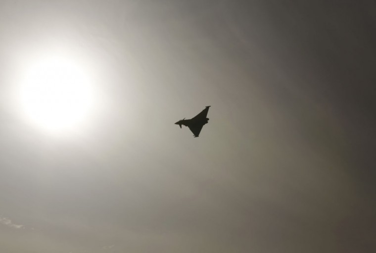 "A U.S. Air Force F-22 flies over the Bahraini desert during the Bahrain International Airshow in Sakhir, Bahrain, Friday, Jan. 22, 2016. Lockheed-Martin's F-22 is the U.S. Air Force's newest fighter aircraft, which a U.S. Air Force commander participating in the air show events described as ""very capable."" (AP Photo/Hasan Jamali)"