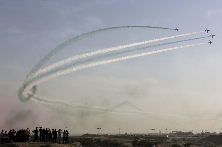 Spectators watch from the desert as the Saudi Hawks Aerobatic Team of the Royal Saudi Air Force performs during the Bahrain International Airshow in Sakhir, Bahrain, Friday, Jan. 22, 2016. (AP Photo/Hasan Jamali)