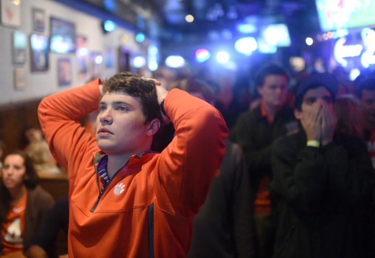 Clemson fan Trey Funderburke reacts to an Alabama touchdown in the NCAA college football playoff championship game at Tiger Town Tavern in Clemson, S.C. (Rainier Ehrhardt/AP)