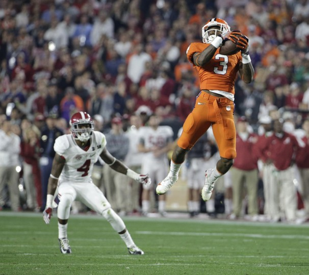 Clemson's Artavis Scott catches a pass in front of Alabama's Eddie Jackson during the first half of the NCAA college football playoff championship game. (David J. Phillip/AP)