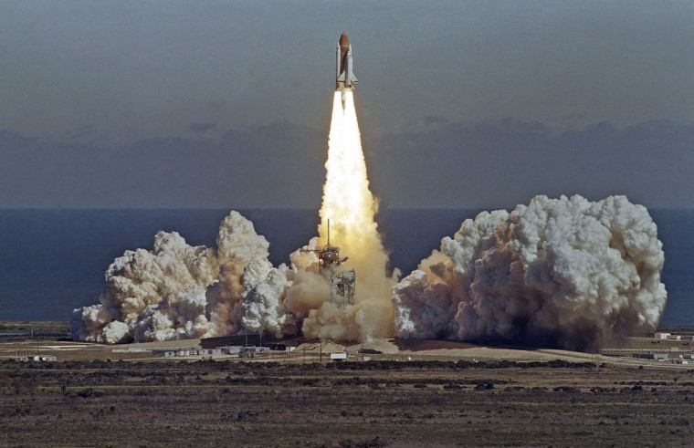 In this Jan. 28, 1986 picture, the space shuttle Challenger lifts off from the Kennedy Space Center in Cape Canaveral, Fla. shortly before it exploded with a crew of seven aboard. (AP Photo/Thom Baur)