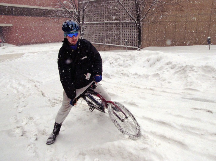 Bicycle messenger Chris Schmuck, of Baltimore, makes his way up a hill at E. Franklin street after making a delivery for Laser Courier service. (Kenneth K. Lam/Baltimore Sun)