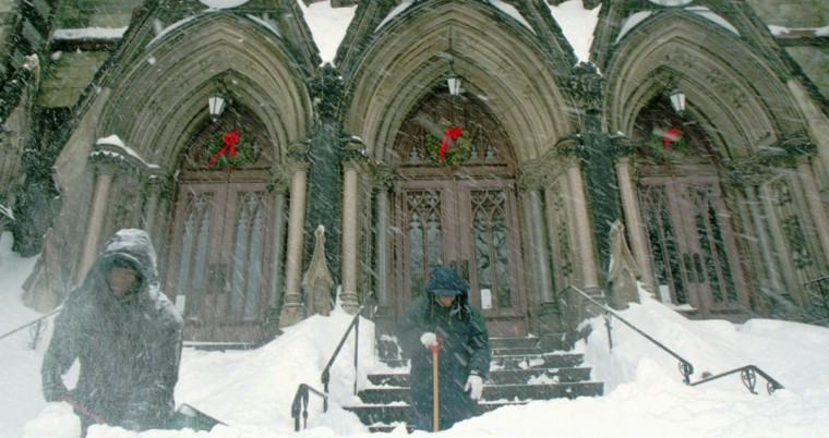 Daniel Jones (left) and John Moore are trying to keep the church clear for anyone who feels the need to worship during the storm. This is Mount Vernon Place United Methodist Church. (Hillery Smith/Baltimore Sun)