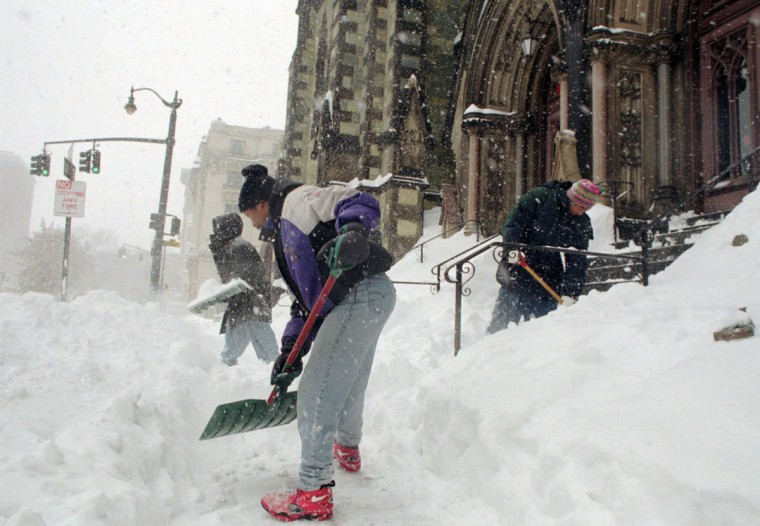 Ron Corbin (front) is the Custodian for the Mount Vernon Place United Methodist Church. He and Daniel Jones (left) and John Moore Right are trying to keep the church clear for anyone who feels the need to worship during the store. (Hillery Smith/Baltimore Sun)