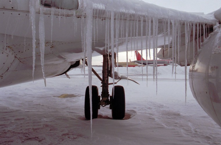 Icicles dangle from the left wing of a USAir passenger jet from melting snow that refreezes at the gate of Baltimore Washington International Airport Mon., Jan. 8, 1996. BWI Airport remained closed for another day as crews struggled to keep blowing snow from accumulating on the runways. (Baltimore Sun/Karl Merton Ferron)