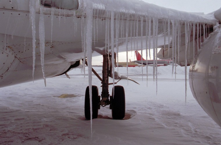 January 8, 1996 -- Icicles dangle from the left wing of a USAir passenger jet from melting snow that refreezes at the gate of Baltimore Washington International Airport. BWI Airport remained closed for another day as crews struggled to keep blowing snow from accumulating on the runways. (Karl Merton Ferron/Baltimore Sun)