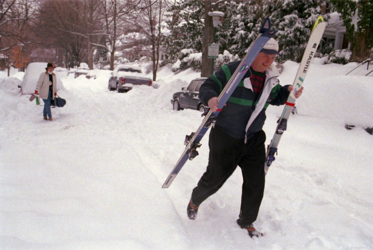 Jeff Harris, the only block resident with a 4 wheel drive vehicle, helped others during the week. By Friday, he was ready for more snow - packing skis, wife Ann (in back, left) and baby son in a 4x4 to visit relatives and do some skiing in PA. (Amy Davis/Baltimore Sun)