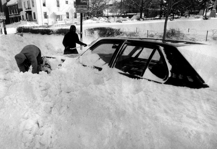February 13, 1983 -- People digging their car out of snow, on the 2900 Block of Charles. (William Hotz/Baltimore Sun)