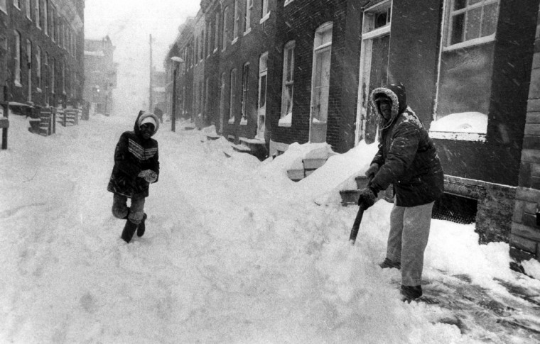 February 13, 1983 -- Howard Hursey shovelling snow in front of his house at 1201 Wilcox Street with help of his daughter, Tammy, 10 (Weyman Swagger/Baltimore Sun)