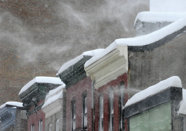 February 10, 2010 -- High winds whip snow off roofs on Park Ave. in Baltimore City. (Jed Kirschbaum/Baltimore Sun)