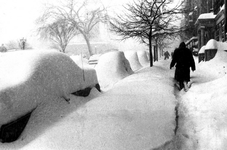February 19, 1979 -- A pedestrian on Mount Vernon Place makes his way past snow-covered parked cars about 8:45AM yesterday after the  blizzard. (Ralph L. Robinson/Baltimore Sun)