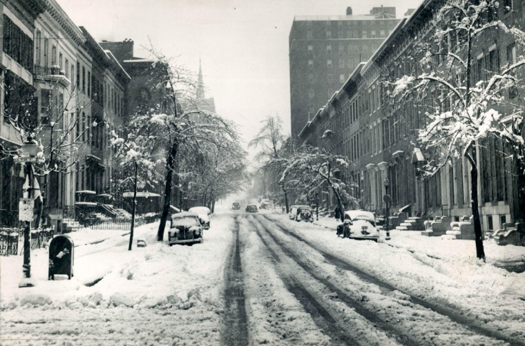 St Paul Street looking North from Read Street is snow covered following a storm in March 1942.   (Baltimore Sun)