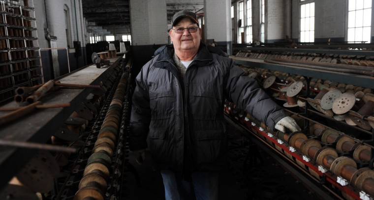 "Herb Crawford, who has owned the Klots Throwing Company Mill, a silk mill in Lonaconing, suddenly closed suddenly in 1957. Much of what was inside at the time still remains. Herb Crawford, who has owned the mill for 39 years, has been trying to keep the historic mill intact. The roof is in need of repair, but Crawford can only afford ""band-aid"" repairs. (Kim Hairston/Baltimore Sun)"