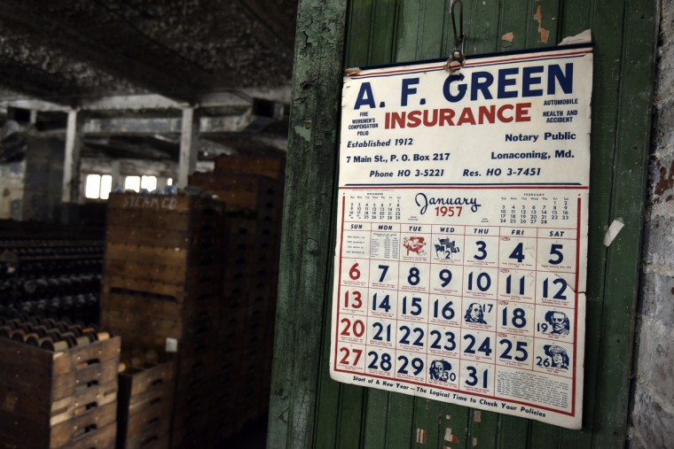 A wall calendar reads January 1957, but it was in July of that year that General Textile Mills, which ran the silk mill in Lonaconing, suddenly closed its doors. Built as the Klots Throwing Company Mill in April of 1907, much of what was inside at the time of the closing still remains. (Kim Hairston/Baltimore Sun)