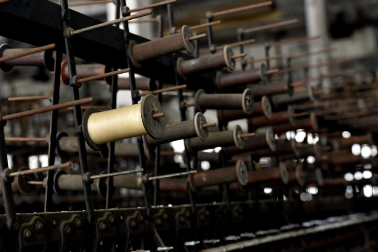 "Antique silk thread on a bobbin.The Klots Throwing Company Mill, a silk mill in Lonaconing, that closed suddenly in 1957. Much of what was inside at the time still remains. Herb Crawford, who has owned the mill for 39 years, has been trying to keep the historic mill intact. The roof is in need of repair, but Crawford can only afford ""band-aid"" repairs. (Kim Hairston/Baltimore Sun)"