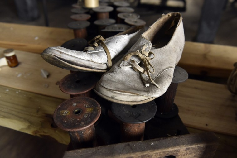 Shoes inside the Klots Throwing Company Mill are among the personal items left behind when the factory closed its doors in 1957. It is the last intact silk mill in the U.S.  Much of what was inside at the time still remains.  (Kim Hairston/Baltimore Sun)