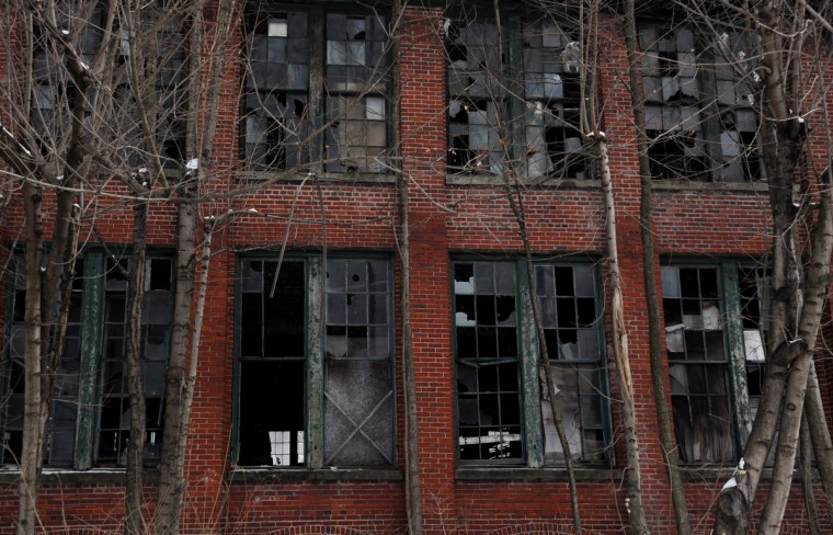 "Broken windows let the elements into the old Klots Throwing Company Mill, a silk mill in Lonaconing that closed suddenly in 1957. Much of what was inside at the time still remains. Herb Crawford, who has owned the mill for 39 years, has been trying to keep the historic mill intact. The roof is in need of repair, but Crawford can only afford ""band-aid"" repairs. (Kim Hairston/Baltimore Sun)"