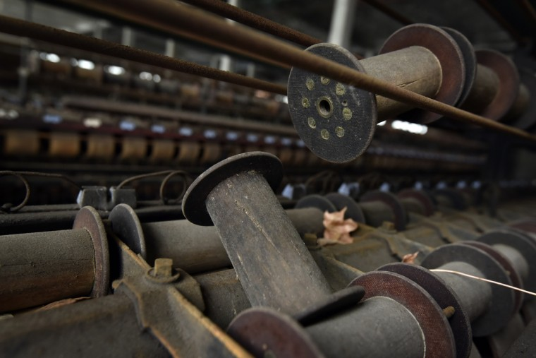 "Bobbins. The Klots Throwing Company Mill, a silk mill in Lonaconing, closed suddenly in 1957. Much of what was inside at the time still remains. Herb Crawford, who has owned the mill for 39 years, has been trying to keep the historic mill intact. The roof is in need of repair, but Crawford can only afford ""band-aid"" repairs. (Kim Hairston/Baltimore Sun)"