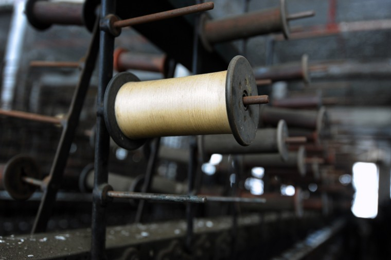 "Silk thread on a bobbin at the old Klots Throwing Company Mill, a silk mill in Lonaconing that closed suddenly in 1957. Much of what was inside at the time still remains. Herb Crawford, who has owned the mill for 39 years, has been trying to keep the historic mill intact. The roof is in need of repair, but Crawford can only afford ""band-aid"" repairs. (Kim Hairston/Baltimore Sun)"