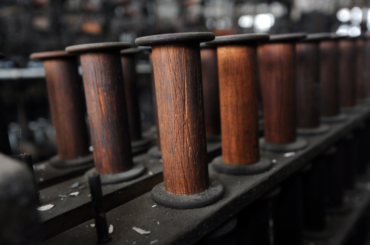 "Wooden bobbins in the old Klots Throwing Company Mill, a silk mill in Lonaconing that closed suddenly in 1957. Much of what was inside at the time still remains. Herb Crawford, who has owned the mill for 39 years, has been trying to keep the historic mill intact. The roof is in need of repair, but Crawford can only afford ""band-aid"" repairs. (Kim Hairston/Baltimore Sun)"