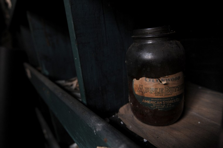 "A large apple butter jar is one of the many things left at the silk mill in Lonaconing when it closed suddenly in 1957. Started as the Klots Throwing Company Mill, the building is the last intact silk mill in the U.S.   Herb Crawford, who has owned the mill for 39 years, has been trying to preserve the historic building. The roof is in need of repair, but Crawford can only afford ""band-aid"" repairs.  (Kim Hairston/Baltimore Sun)"