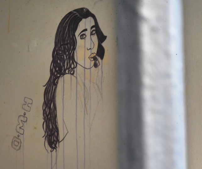 Seen through the bars of an inmate's cell is graffiti of a woman blowing a police whistle, drawn in magic marker in C section of the closed Men's  Detention Center. (Amy Davis/Baltimore Sun)