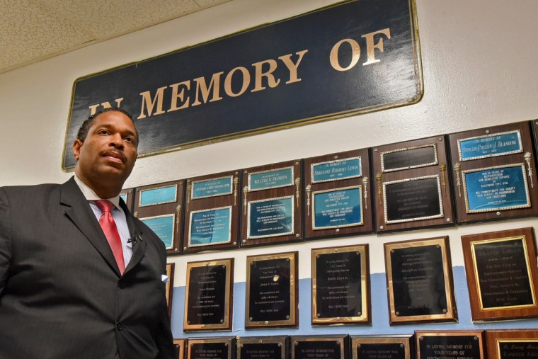During a tour of the closed Men's  Detention Center, Lt. Melvin Easley, a former guard who is now the public information officer for the Division of Pretrial and Detention Services, pauses by a wall of memorial plaques for coworkers who died during their term of service: gone but not forgotten. The employees paid for the plaques. (Amy Davis/Baltimore Sun)
